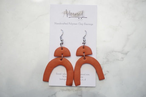 Burnt orange rainbow shape earrings