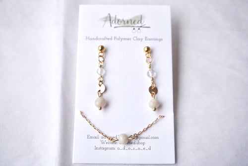 Gold dangles with crystal and pearly clay bead