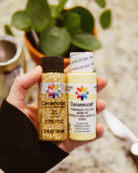 craft paints in two different colors, yellow and gold glitter