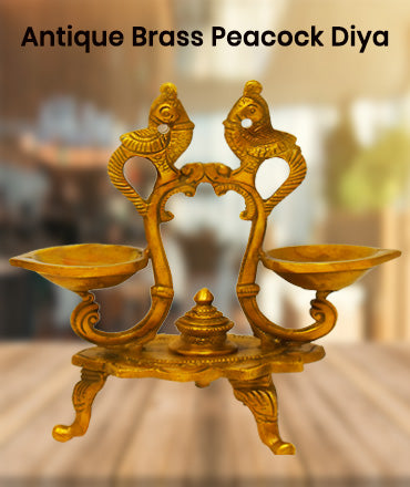 Buy online brass diya at ashtok. pure brass diya for pooja item and home decor. Buy best price online brass peacock diya at reasonable price.