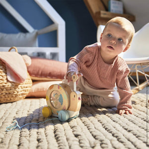 Janod Pure Pull-Along Snail | Wooden Toddler Activity Toy | Lifestyle – Baby Playing with Pure Pull-Along Snail | BeoVERDE.ie