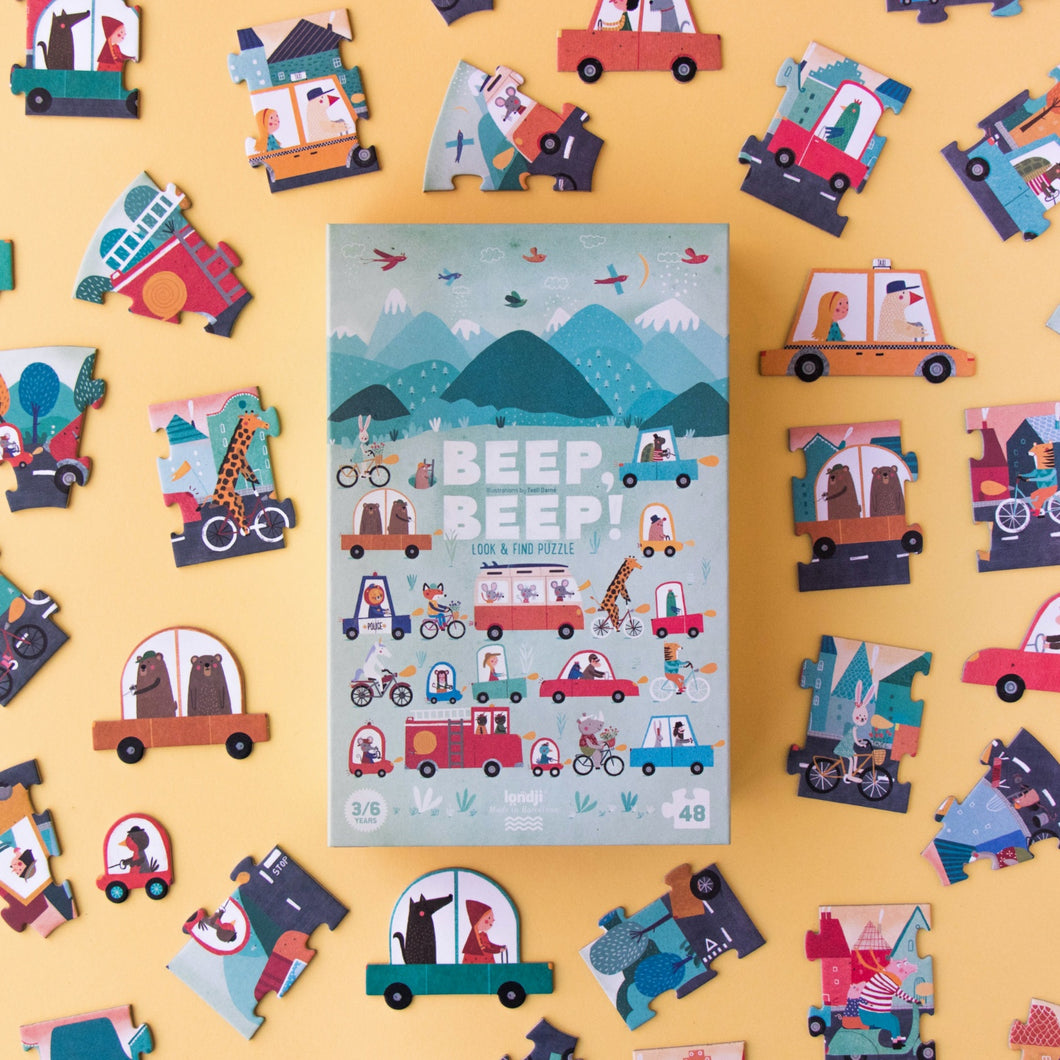Londji BEEP BEEP! Jigsaw Puzzle | Designed by Txell Darne Jigsaw Puzzle and Game | Perfect Jigsaw Puzzle for Kids 3 Years and Older | Front View – Box with Jigsaw Puzzle Pieces Around | BeoVERDE.ie
