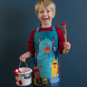 ThreadBear Design Children's Apron 'The Scruffles' | Boy Wearing Apron And Holding A Paint Brush | BeoVERDE.ie