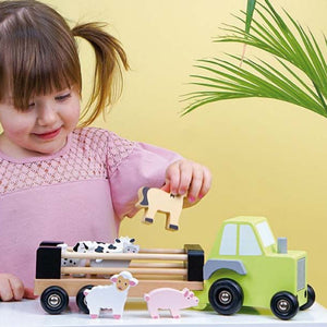 JaBaDaBaDo Farm Tractor | Wooden Imaginative Play Toy | Side View – Girl Playing | BeoVERDE.ie