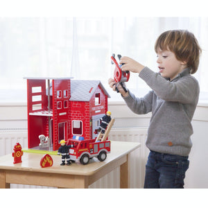New Classic Wooden Toy Fire Station Play Set | Imaginative Play Toys | Lifestyle – Boy Playing with Wooden Figure | BeoVERDE.ie