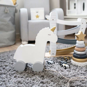 JaBaDaBaDo Pull-Along Unicorn | Scandi Style Wooden Toddler Activity Toy | Lifestyle – On Shelf | BeoVERDE.ie