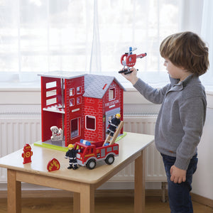 New Classic Wooden Toy Fire Station Play Set | Imaginative Play Toys | Lifestyle – Boy Playing | BeoVERDE.ie