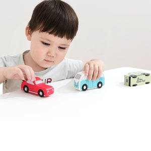 New Classic Toys Wooden Shape Sorter Truck | Baby & Toddler Activity Wooden Toy | Lifestyle - Boy Playing with Two Cars on Table | BeoVERDE.ie