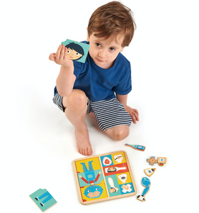 Tender Leaf Ouch Puzzle | Hand-Crafted Wooden Educational Toy | Boy Showing Puzzle Pieces | BeoVERDE.ie