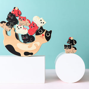 Vilac Catymini Balancing Game Designed by Ingela P. Arrhenius  | Hand-Crafted Wooden Toy | Wooden Stacking Balancing Game | Front View – Lifestyle – Some Kittens on Mother Cat, Mouse on One Kitten | BeoVERDE.ie