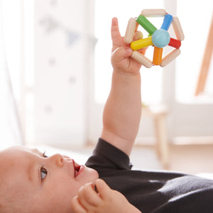 Colour Carousel | Clutching Toy | Baby's First Wooden Toy | HABA | Lifestyle: Baby Holding Clutching Toy | BeoVERDE.ie
