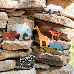 Tender Leaf Safari Animals | Hand-Crafted Wooden Animal | Outside Wooden Safari Animals On Stone Wall | BeoVERDE.ie
