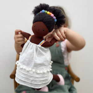 ThreadBear Design Esme Rainbow Rag Doll | Hand-Crafted Rag Doll | Soft Cotton Children's Doll | Lifestyle – Girl Holding Rag Doll Esme | BeoVERDE.ie