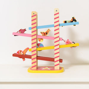 Vilac Acrobat's Cascade designed by Ingela P.Arrhenius | Wooden Toddler Activity Toy | Lifestyle - Side View  - Figures Rolling | BeoVERDE.ie