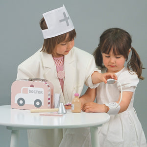 JaBaDaBaDo Doctor's Case Pink | Wooden Pretend Play Toy | Lifestyle – 2 Girls Playing Blood Pressure Monitor | BeoVERDE.ie