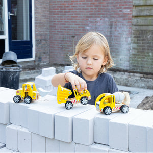 New Classic Toys Wooden Toy Construction Site Vehicle Set | Baby & Toddler Activity Wooden Toy | Lifestyle – Child Playing on Wall | BeoVERDE.ie