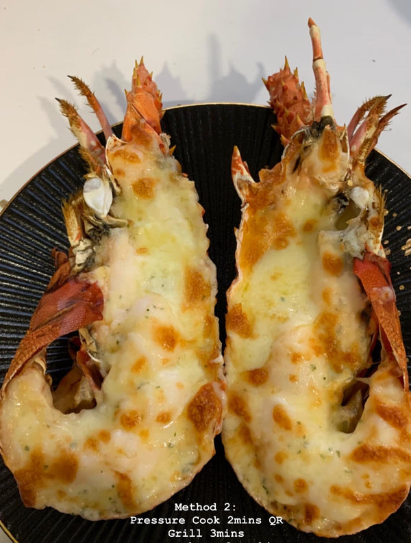 Garlic Butter Cheese Lobster on a plate