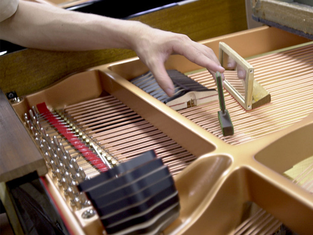 Making a grand piano: 4. Strings & action
