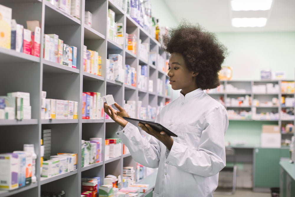 A pharmacy technician doing inventory