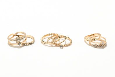 Set of 8 Textured Metal and Hearts Rings