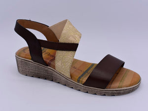 Brown sandals with gold feature