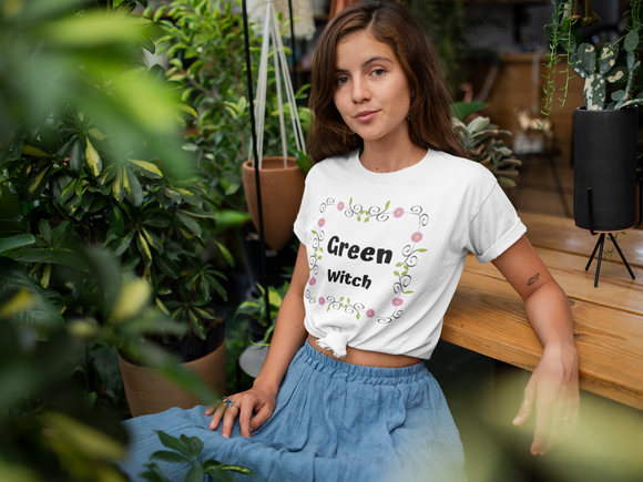 A girl wearing witch clothing. A Green witch t shirt