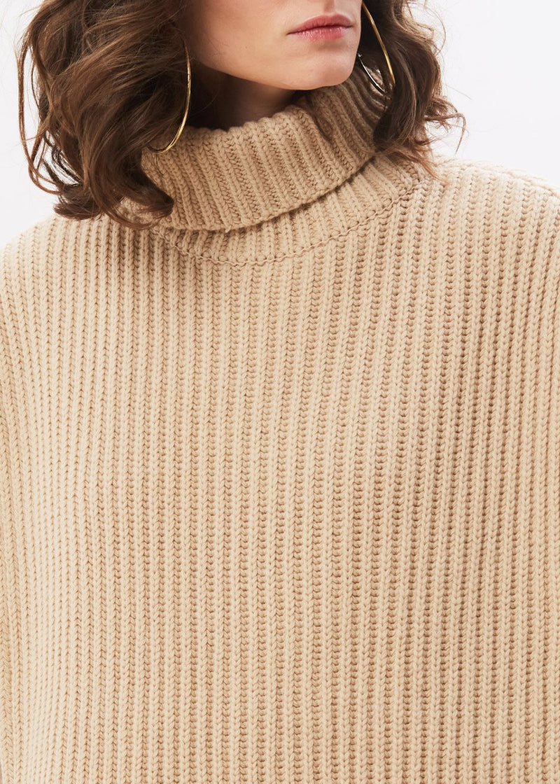 Roll Neck Poncho Knit in Oat Milk
