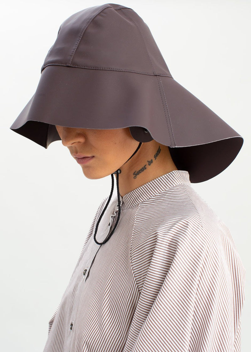 Rubber Rain Hat by KASSL Editions in Dark Chocolate