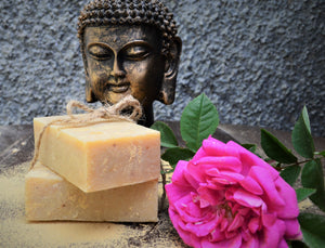 Himalayan Clay and Rose Soap with a pink rose next to it