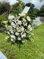 Spider White, white carnations, white monte casino, white asiactic lily with white snapdragon and greenery