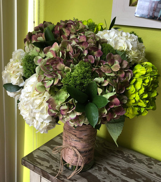 A peaceful green floral arrangement of white, green and brown Hydrangea ideal for expressing your condololences.