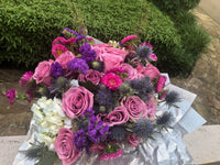 A Hand tie Bouquet for Lavender Roses, Purple Aster, Blue Lagoon Eryngium, Purple Statite, Wet Wheat and white Hydrangea.