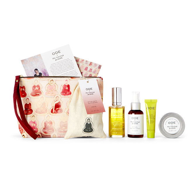 candle, bath salts, body oil, tonic and moisturizer with red cosmetic bag