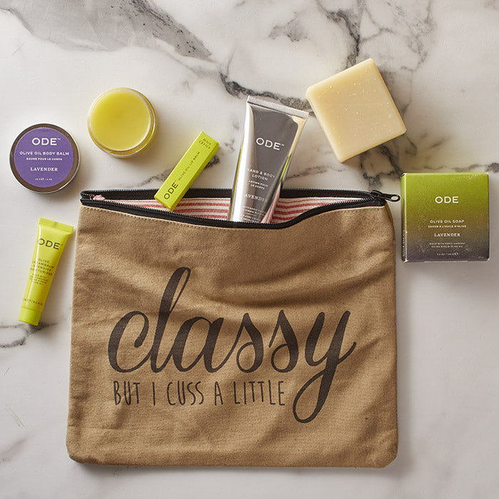 tote with lavander lotion tube, body balm, soap bar, lip balm and moisturizer