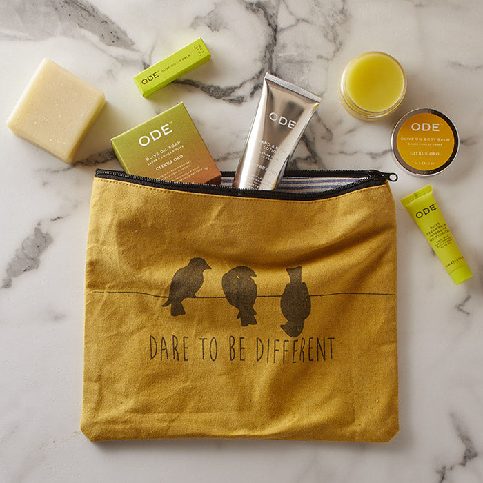 tote with citrus oro lotion tube, body balm, soap bar, lip balm and moisturizer