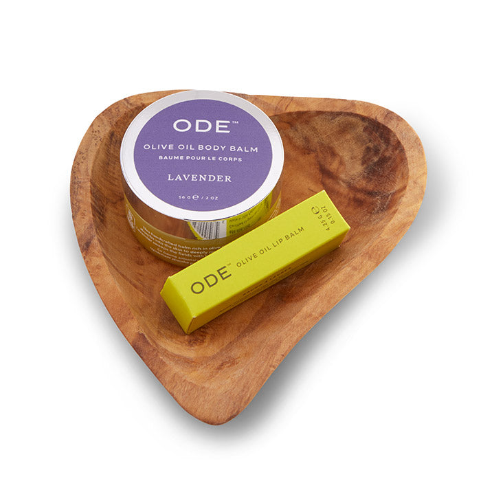 lavander body balm and lip balm on a teak heart shaped dish