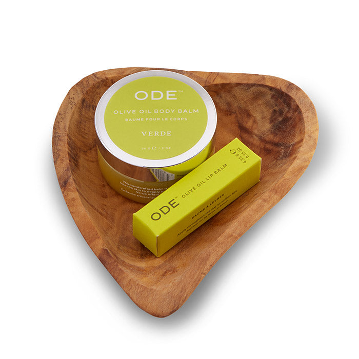 verde body balm and lip balm on a teak heart shaped dish