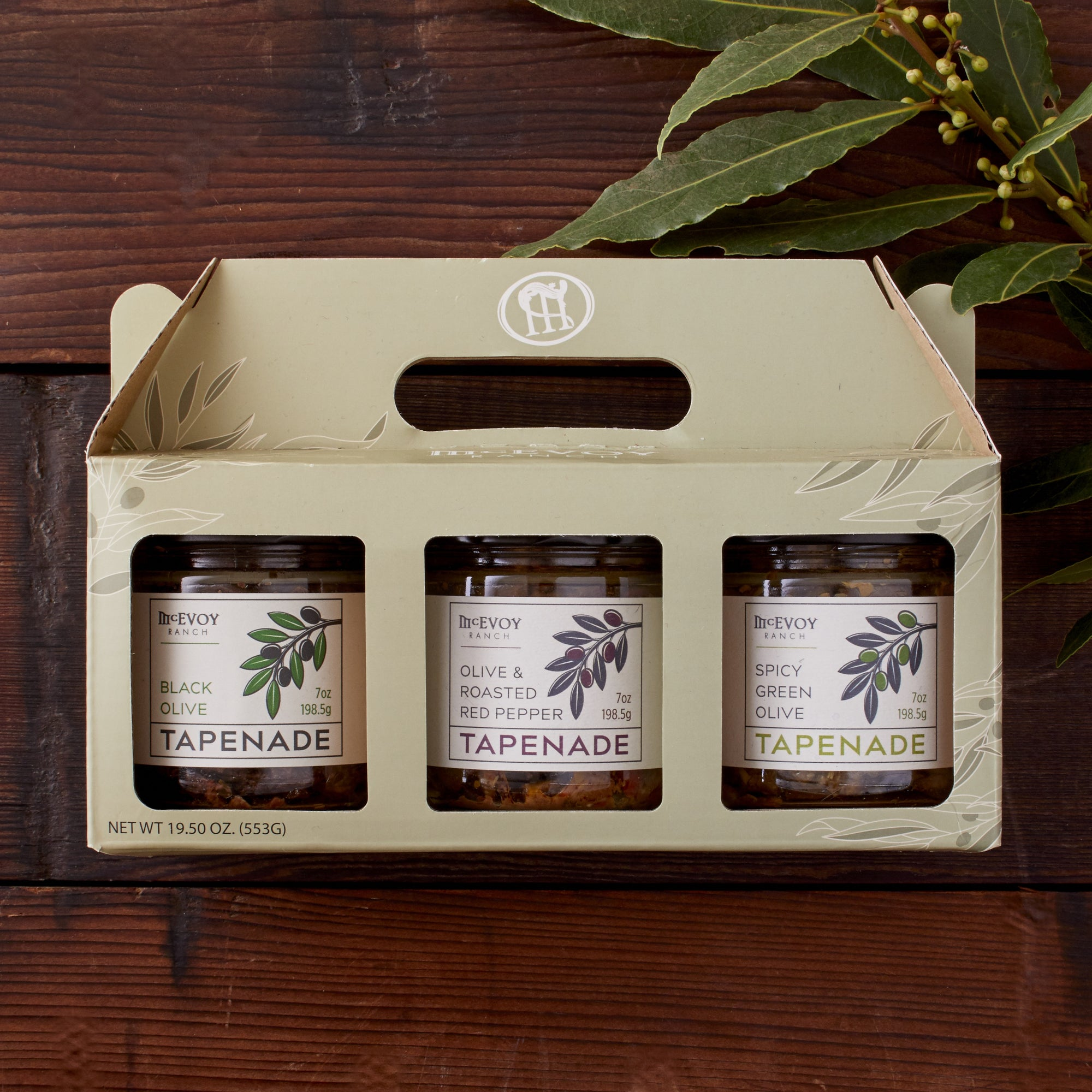 jars of olive tapenade in box