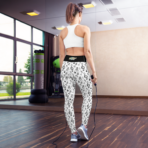 Back view of a Girl in a gym wearing white yoga high waist yoga leggings with music notes print