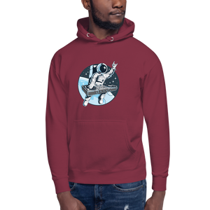 Man wears maroon hoodie with front pouch pocket and astronaut djing on cdjs front print