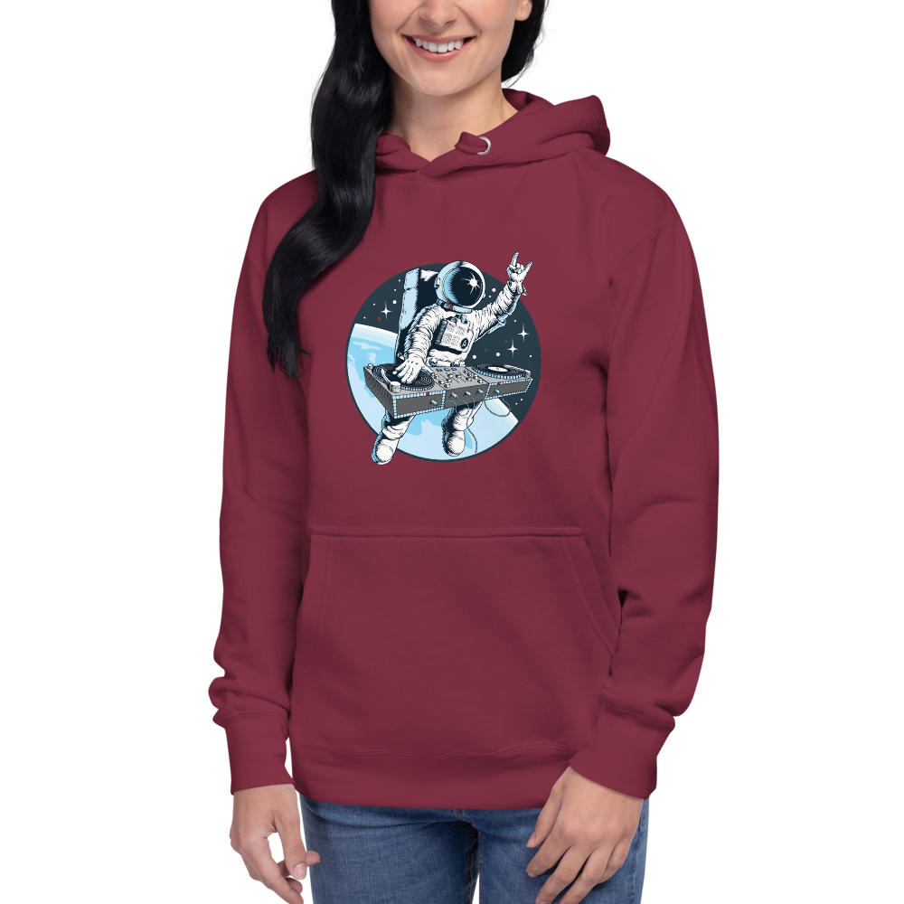 Model wears maroon hoodie with front pouch pocket and astronaut djing on cdjs front print