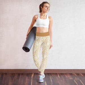 model wears white Fall leaves print yoga leggings