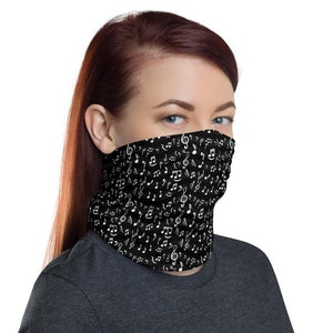 Woman wears black face cover with music notes pattern