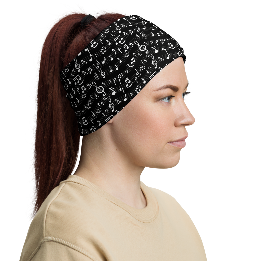 Woman wears black headband with music notes pattern