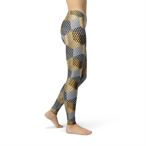 Models wears shiny gold and grey geometric pattern leggings