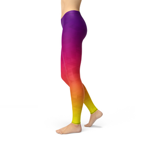 side view of colorful purple, pink, yellow rainbow leggings