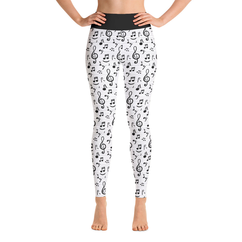 Front view of white yoga high waist yoga leggings with music notes print