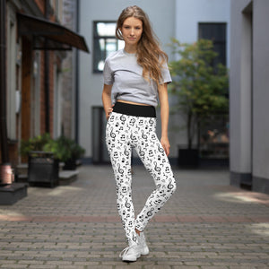 Girl wears white yoga high waist yoga leggings with music notes print