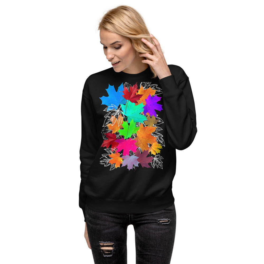 girl wears black pullover with a print of colorful fall leaves