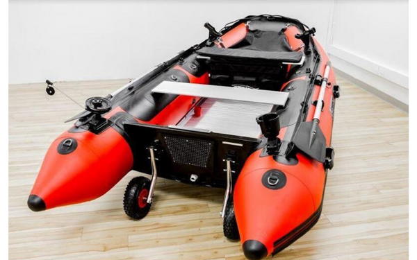 Red and black inflatable boat in showroom.